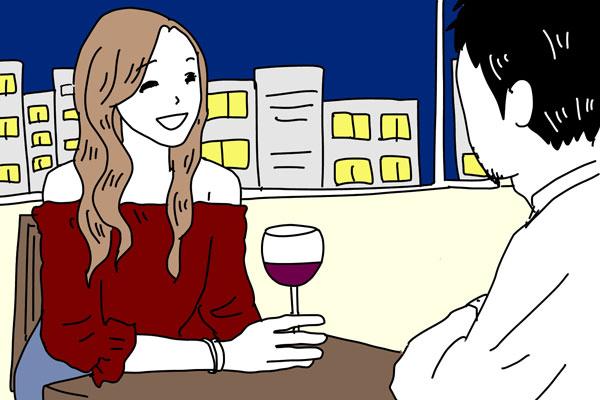 夜景の見える場所でディナーをする男女