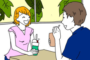 カフェでデートをする若い男女